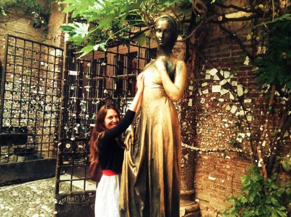 rubbing juliet's bosom for luck in verona, italy.