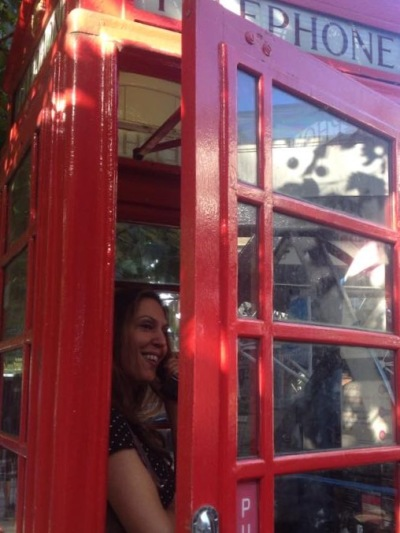 me being a dork in a london phone booth