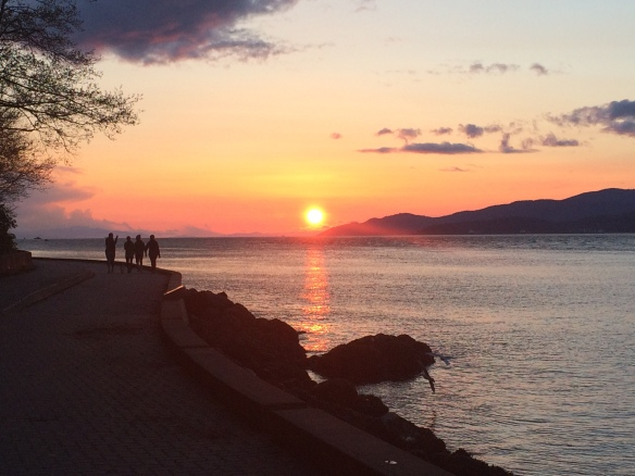 seawall walkers at sunset